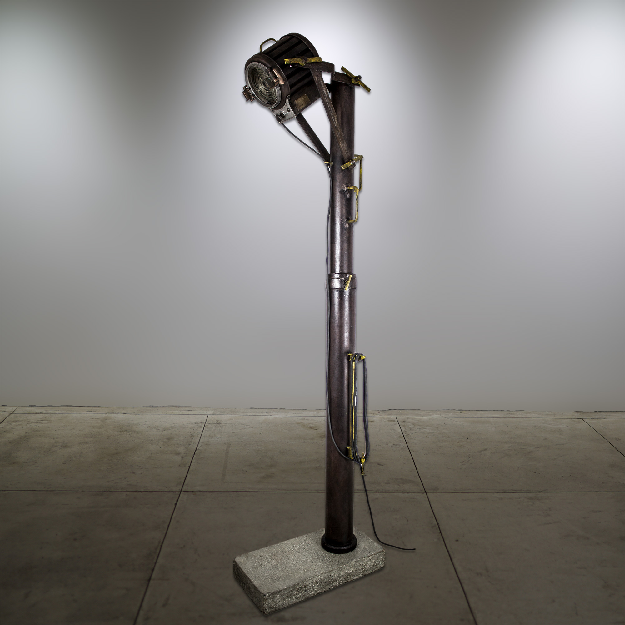 """Mole-Richardson + Motion Picture Lamp"" - Concrete base, Metal column - 24""x12""x80"" - © Flavio Bisciotti"