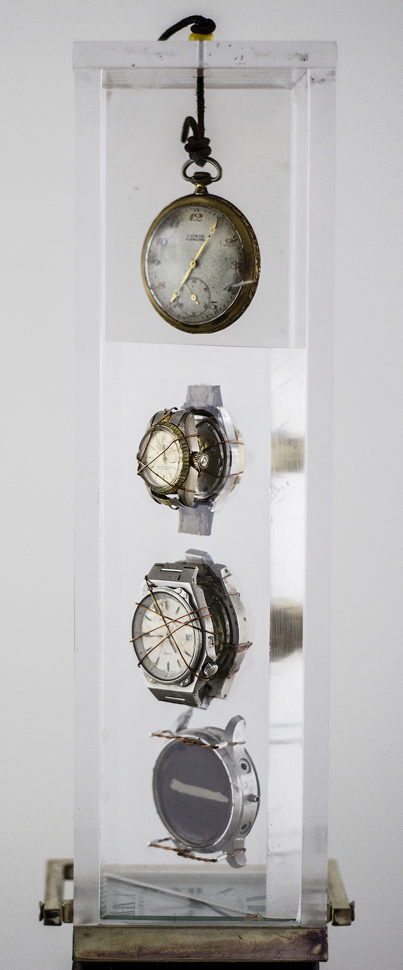 """Time"" - Sculpture, Metal base, burned wood, Watches, Acrylic Box - 4""x4""x67-1/2"" - © Flavio Bisciotti"